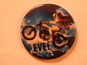 Evel Knievel button on Harley jump bike in the clouds