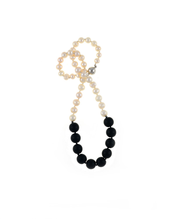 Copacabana Promenade II - Pearl Necklace with Onyx ,Single strand graduated white freshwater pearls 6-10mm, leading to untumbled onyx beads 12mm, on individually hand knotted natural silk, with rare earth mixed metal clasp