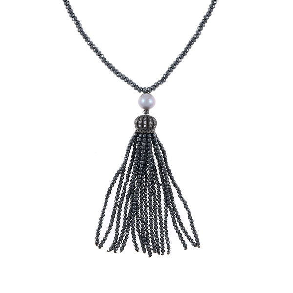 """Cotton Club Collection* - Hematite and Pearl Jewelry, Zoom of gunmetal tassel: Single strand gunmetal tone hematite bead necklace with white freshwater pearl 9mm, suspended with CZ set gold toned crown supporting  hematite bead tassel, overall drop 3"""", 32"""" in length."""