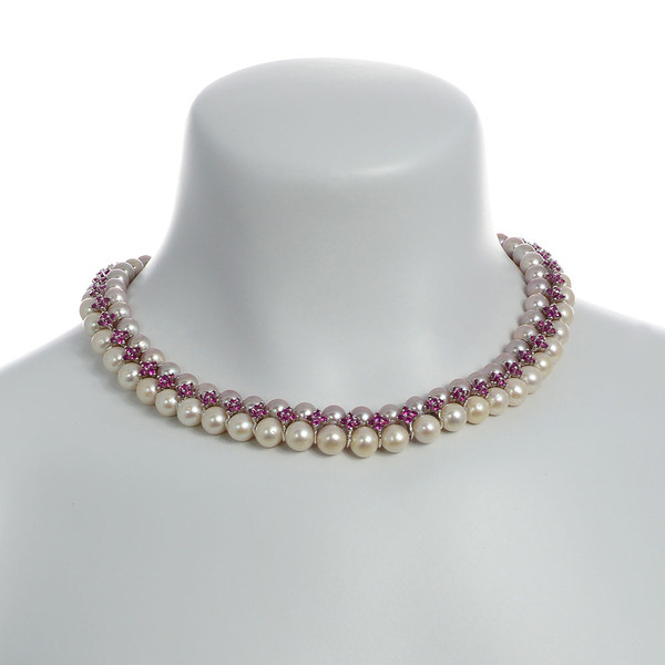 """on model Monaco Rose necklace: double strand 7-8mm natural color freshwater pink pearls, white 8-9mm freshwater pearls, separated by stainless steel and rose colored CZ spacers, sterling silver clasp on hand-knotted natural silk, 18"""" in length with jump chain allows for additional overall 20"""" length, (princess length, expands to matinee length)"""