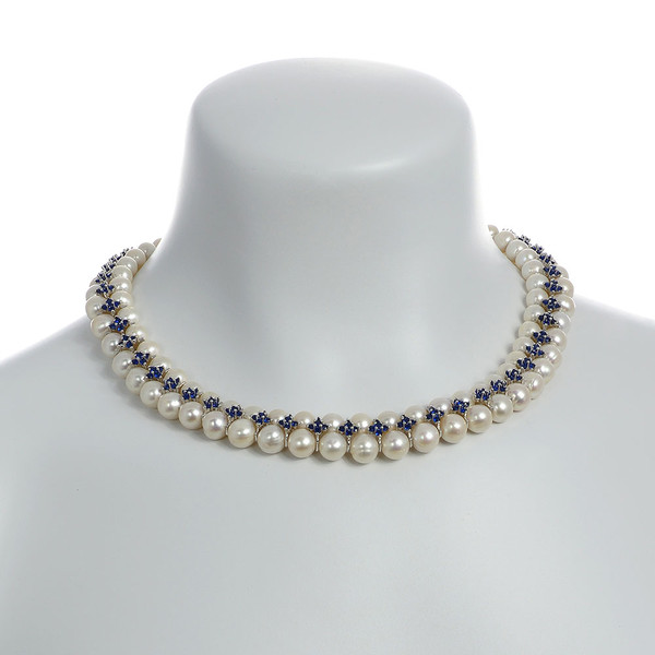 """on model, Monaco Royal necklace: double strand white 7-8mm freshwater pearls, white 8-9mm freshwater pearls, separated by stainless steel and royal blue colored CZ spacers, sterling silver clasp on hand-knotted natural silk, 18"""" in length with jump chain allows for additional overall 20"""" length, (princess length, expands to matinee length)"""