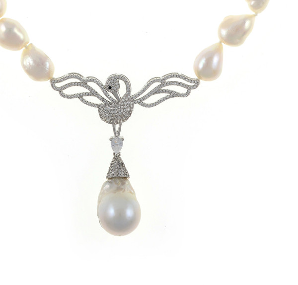 """Odette Anthology* - Pearl Necklace, zoom of silver-tone CZ swan, Odette Silver-tone: Single strand white potato pearls 13-14mm, 7cm CZ silver-tone swan pendant with biawa 18-19mm, CZ covered silver-tone mixed metal locking circle clasp, 18"""" in length, princess length"""