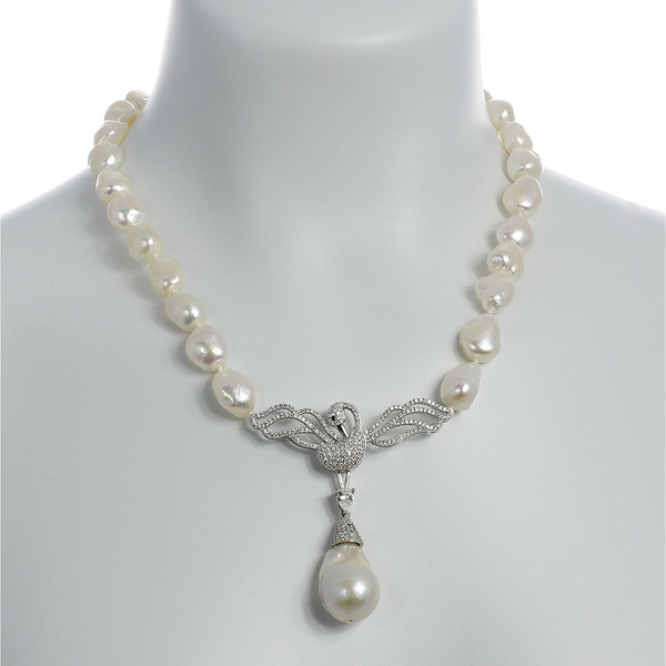 """Odette Anthology* - Pearl Necklace on model, Odette Silver-tone: Single strand white potato pearls 13-14mm, 7cm CZ silver-tone swan pendant with biawa 18-19mm, CZ covered silver-tone mixed metal locking circle clasp, 18"""" in length, princess length"""