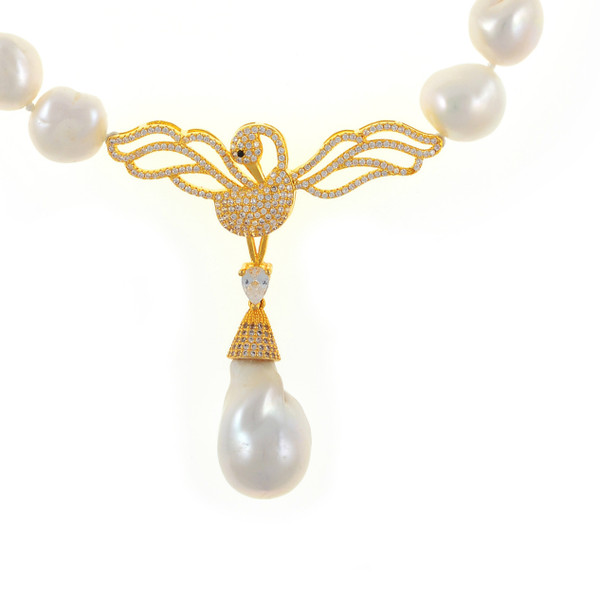 """Odette Anthology* - Pearl Necklace zoom of gold-tone CZ swan, Odette Gold-tone: Single strand white potato pearls 13-14mm, 7cm CZ gold-tone swan pendant with biawa 18-19mm, CZ covered gold-tone mixed metal locking circle clasp, 18"""" in length, princess length"""
