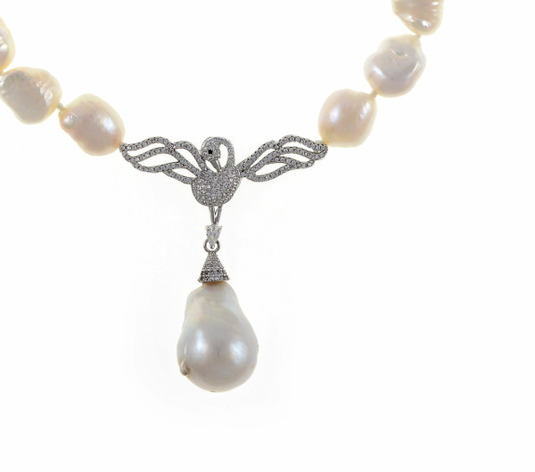 """Petit Odette Pearl Necklace in Silver, zoom on CZ silver-tone swan, Single strand white 11-12mm potato pearls, 5 cm CZ set silver-tone swan pendant with 13-15mm single biawa pearl pendant. CZ covered mixed metal locking circle clasp, 18"""" in length (princess length)"""