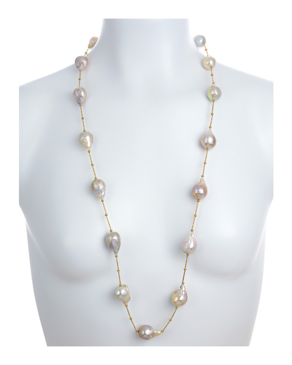 on model Appalachian Spring Pearl necklace: Natural color pink 14-17mm edison pearls, brass separator and beads, brushed gold tone moonlight clasp set with a single CZ