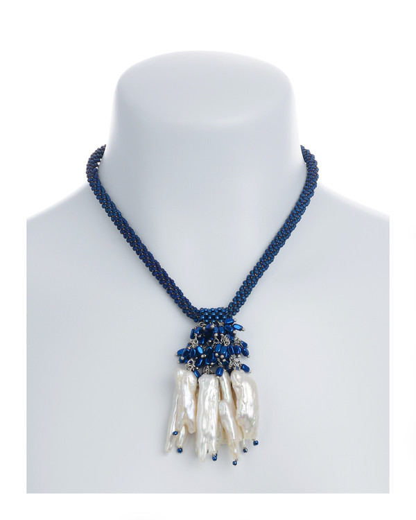 """The Luray Treasury* Pearl Necklace on model in Royal: Hand-woven royal matte hematite bead necklace with 8 dangling tooth freshwater pearls and matching polished hematite beads, with rare earth mixed metal magnetic clasp, 17"""" length with 2.5"""" tooth pearl drop."""