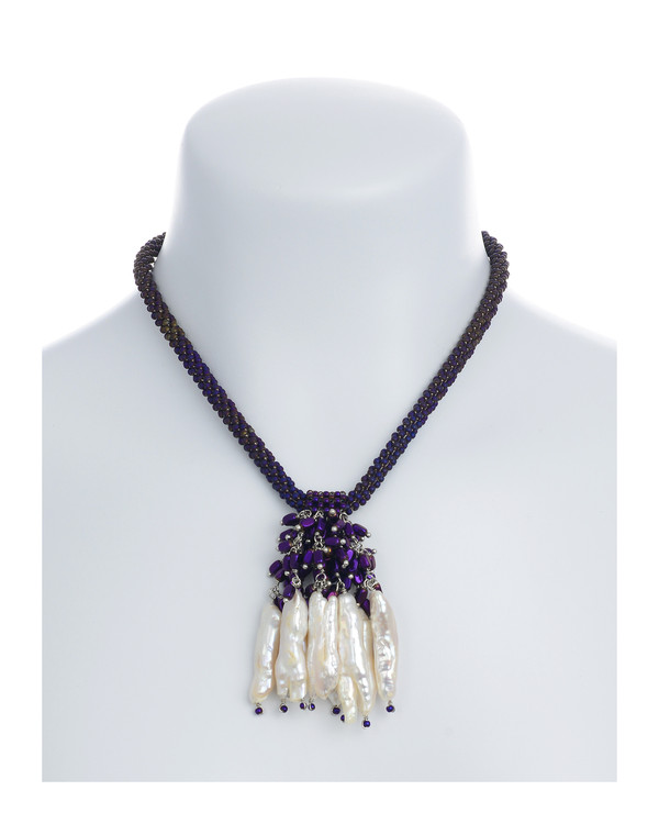 """The Luray Treasury* Pearl Necklace on model in Amethyst necklace:Hand-woven amethyst matte hematite bead necklace with 8 dangling tooth freshwater pearls and matching polished hematite beads, with rare earth mixed metal magnetic clasp, 17"""" length with 2.5"""" tooth pearl drop."""