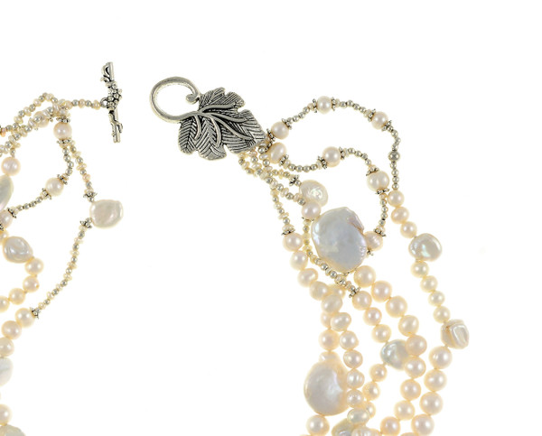 """zoom of White Cliffs Pearl necklace leaf clasp and pearls: 5 strands of mixed sized seed pearls mixed with freshwater pearls, keshi, coin, and stick pearls, and dotted with glass beads,individually hand-knotted on silk, featuring a mixed metal leaf toggle clasp, 18"""" in length (princess length)"""