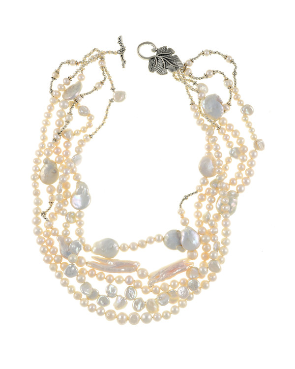 """White Cliffs Pearl necklace: 5 strands of mixed sized seed pearls mixed with freshwater pearls, keshi, coin, and stick pearls, and dotted with glass beads,individually hand-knotted on silk, featuring a mixed metal leaf toggle clasp, 18"""" in length (princess length)"""