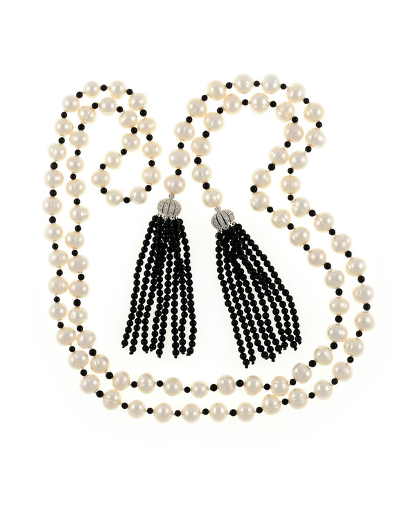 """Salome Pearl necklace, 9-10mm white round freshwater pearls separated with onyx, individually hand-knotted on silk, with 2 black onyx tassels can be worn wrapped, draped, tied, or looped, 50"""" in length (rope length)."""