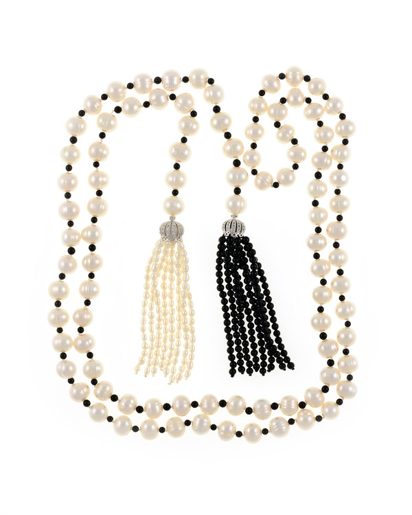 """Salome Pearl necklace, 9-10mm white round freshwater pearls separated with onyx, individually hand-knotted on silk, with 2 black onyx tassels, Can be worn wrapped, draped, tied, or looped, 50"""" in length (rope length)."""