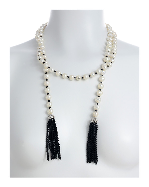 """Salome Pearl necklace with 2 black tassels, 9-10mm white round freshwater pearls separated with onyx, individually hand-knotted on silk, on model, Can be worn wrapped as shown, 50"""" in length (rope length)"""