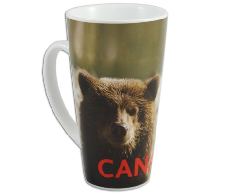 Bear pictured with natural background on a ceramic latte mug.