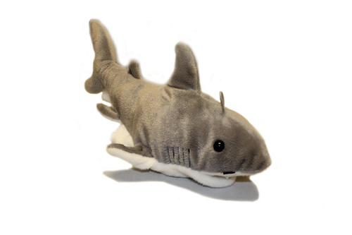 Shark puppet with white bottom and grey/brown top.