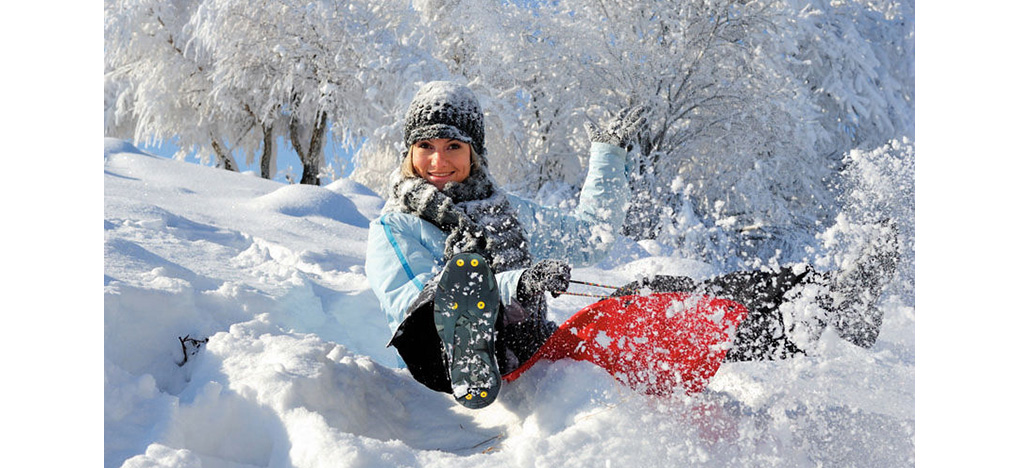 Girl wearing ice cleats in snow