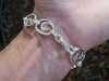 heavy crashing wave bracelet in solid sterling with swivel clasp on a man's wrist