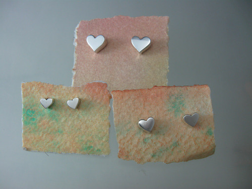 Selection of Smooth Post earrings shown on the hand made cards they come to you on .
