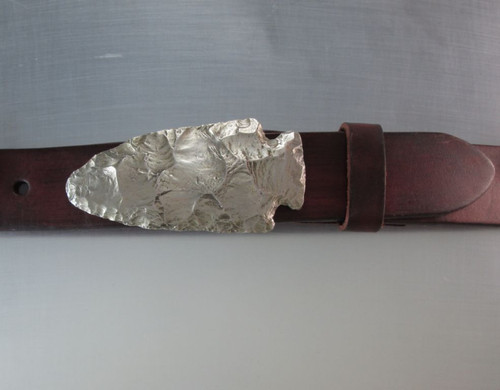 Spear head buckle cast in white bronze with natural patina and satin finish.   Fits up to inch and a quarter belt