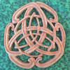 Peace and unity of the inner Heart, Mind and Spirit reflected outward into the larger world represented by the Celtic Peace Knot wood carving.