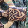 Details of Burning on the Irish Harmony Cross