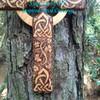 Details of wood burning on the Base member of the Irish Harmony Celtic Cross