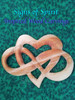 Heart of Infinite Love is carved in the Celtic style, weaving the lines under and over...Entwining to enhance the meaning of your Love embracing Eternity.