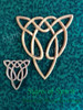 Celtic Wood Carving of Wolf Knot, an artistic variation of the Celtic Knot of Everlasting Love.