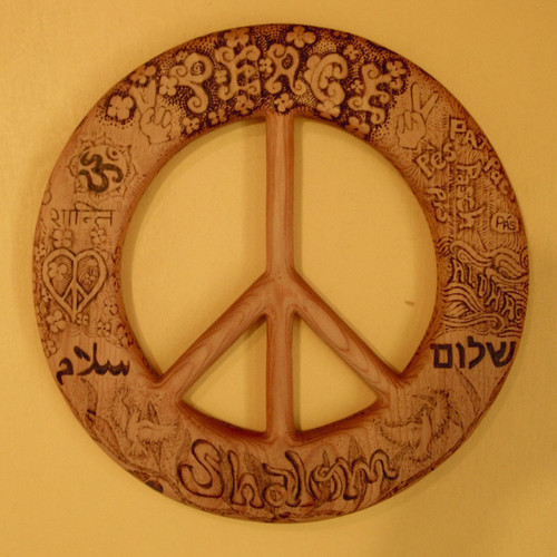 Wood burned Peace Symbol:  Words of Peace in Many languages by Signs of Spirit.  These are stock pictures.  The carving/burning will be made after ordered.  Each will be different, but with the same theme.  If you have anything you specifically like, let me know!