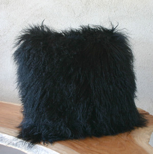 As Shown: Black As Night Mongolian Lamb Pillow Size: 17 x 17 inches  Description: You'll love to cozy up with this noir black Tibetan fur pillow. Its classic hue injects sophisticated texture when tossed in with colorful fabric pillows. By hand, artisans craft these premium designer-quality lambskin cushions. Backed in matching fabric with a feather and down inner, your pillow will be individually created for you.