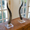 As Shown: Genuine Blesbok Horn Sculpture Size: 18 H inches (each is unique, please allow for variation) Material: Genuine Blesbok Horn on Acrylic Base