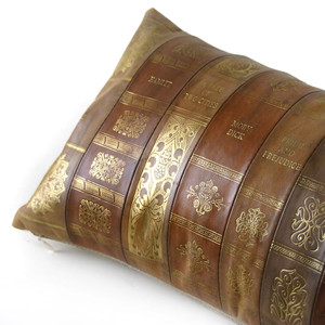 As Shown: Novel Idea Pillow Size: 9 x 18 inches Material: Leather Color: Multicolored   Description: Cozy up with the classics in warm sepia tones embossed with the titles of some of the greats in literature including Moby Dick, Robinson Crusoe, The Great Gatsby, A Tale of Two Cities, War and Peace, Hamlet, Pride and Prejudice, The Grapes of Wrath, and Ulysses. Artisans piece leathers and emboss with gold foil by hand, then back with natural linen or leather. Fitted with a feather and down inner, each is individually crafted for you. This fun lumbar pillow will literately keep you comfortable; it's also a great gift for a book lover.