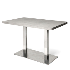 As Shown: Saint Honoré Table Size: 43.25 x 27.5 x 29.5 H inches Material: Concrete, Stainless Steel  Description: Smooth concrete and gleaming stainless steel are the epitome of urban sophistication in a slimly proportioned, modern classic. Its lean lines add streamlined chic to smaller spaces and are especially refreshing when paired with tonal natural materials or darker shades. Made by hand, concrete is blended with sand and fiberglass to create a lightweight and durable material. Finished with a waterproof sealer, it is suitable for interior or exterior use.