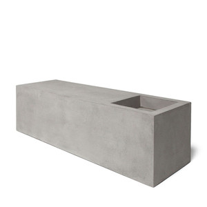 As Shown: Concrete Jungle Low Bench Size: 40 x 12 x 12 H inches Material: Concrete  Description: A minimalist planter for your aromatic herbs, exotic flowers, or even a chic version of a zen garden, with candles and pebbles. Made by hand, concrete is blended with sand and fiberglass to create a lightweight and durable material. Finished with a waterproof sealer, it is suitable for interior or exterior use and is fitted with a removable zinc tray liner.