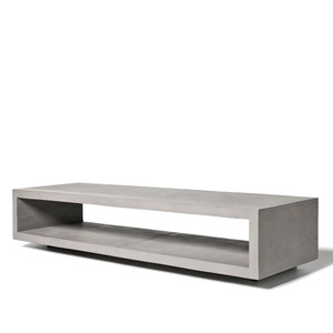 As Shown: Open Wide Concrete Bench Size: 59 x 17.75 x 12.5 H inches Material: Concrete  Description: This piece floats beautifully above the ground, and the hollow central compartment visually lightens it and creates a great space for books or other objects. Made by hand, concrete is blended with sand and fiberglass to create a lightweight and durable material. Finished with a waterproof sealer, it is suitable for interior or exterior use.