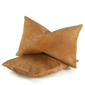 As Shown: North Coast Cowhide Pillow Size: 12 x 18 inches Material: Cowhide Color: Golden Brown  Description: There is no way to create a more classic hair-on hide cushion than this simple design. Available in three neutrals shades, hair-on cowhide is backed with matching cowhide by artisans who then fit it with a feather and down inner. Each is individually created for you. This classic mix of shape, material, and color will be your luxury basic.