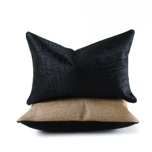 As Shown: Crocodile Cowhide Pillow  Size: 12 x 18 inches Material: Cowhide Color: Black, Golden Brown  Description: Hair-on cowhide becomes a lot bolder with crocodile embossing. Entirely handmade, the embossed front is then backed in linen or leather and fitted with a feather and down inner. Your pillow will be individually created for you. It's a powerful blending of elements of nature that serves you stylishly from ranch to loft.