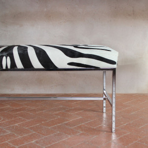 As shown: Faux Zebra Hide Bench Dimensions: 48 x 16 x 19 H inches Materials: Stenciled cowhide, chrome plated steel