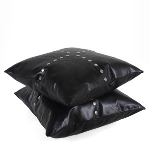 As Shown: Four Corners Pillow  Size: 18 x 18 inches Material: Leather Color: Black  Description: You'll meet up with style and pay homage to the only place in the United States where four states meet: New Mexico, Colorado, Arizona, and Utah. Artisans attach smooth silver studs by hand to the front, then back in matching linen or leather. Fitted with a feather and down inner and hidden zipper, your pillow will be individually created for you. It's simple sophistication for your directional space.