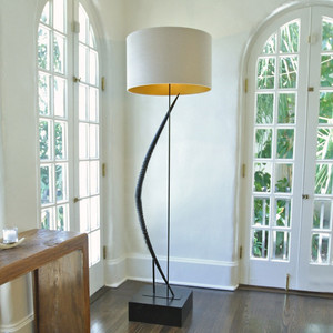 As Shown: Light Curvature Horn Floor Lamp Size: 24 diameter x 79 H inches Material: Genuine Gemsbok Horn on Wooden Base Shade: Linen  Description: In sleek architectural simplicity, two responsibly culled polished Gemsbok horns are hand welded end to end to form this breathtaking floor lamp. Supported by a dark metal rod  and attached to a large polished, black-stained reclaimed Sleeper Wood base, it is topped with a linen shade and takes up to 100 watts. Each piece is unique to you - please allow for variation.