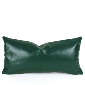 As Shown: Evergreen Leather Pillow Size:  9 x 18 inches Material: Leather Color: Green  Description: This glossy supple piece, available in three styles for your customization, is your go-to classic in soft durable green napa leather. Throw it anywhere for timeless sophistication. Artisans finish the full-grain sheepskin hide front per your specifications, then back in matching leather. Fitted with a feather and down inner and hidden zipper, your pillow will be individually created for you.