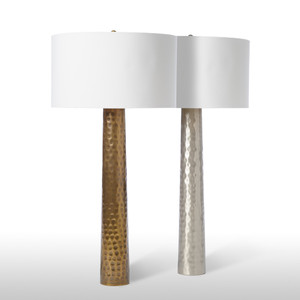 As Shown: Empire State Table Lamp Size: 18 dia x 36 H inches Material: Plated Aluminum Finish: Antique Brass, Shiny Nickel Shade: Silk  Description: Silk and metal combine in a striking visual tableau. This table lamp in hammered antique brass or nickel-plated brass is completed by a gold-lined white silk drum shade. Join with the Empire State Floor Lamp to expand the realm.