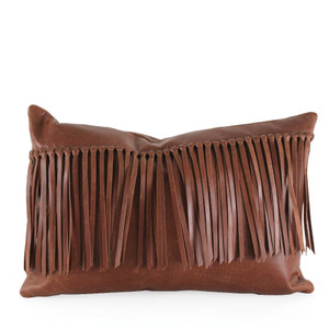 As Shown: Cowboy Fringe Pillow Size: 12 x 20 inches Material: Leather Color: Saddle Brown  Description: Giddy-up your style as knotted long tassels cross the width in a single swath for streamlined flair. Artisans hand-knot and attach fringe at a slight diagonal, then back in matching leather. Fitted with a feather and down inner and hidden zipper, your pillow will be individually created for you. Goes from cowboy casual to biker cool depending on your choice of leather color.