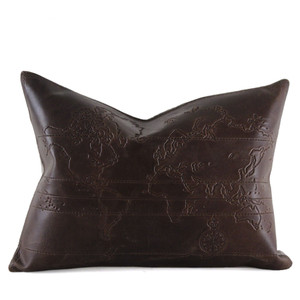 As Shown: Map of the World Pillow Size: 13 x 17 inches Material: Leather  Color: Chocolate Brown  Description: Add old-world charm to your favorite club chair. By hand, artisans emboss the leather front with a pattern of a map of the world. Backed with linen or leather and fitted with a feather and down inner, your pillow will be individually created for you. Pour a scotch and lean back on this handsome addition to your worldly den.