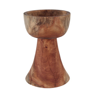 As Shown: Cáliz Bowl Size: 10 dia x 15 H inches Finish: Natural Topcoat: Mineral Oil  Description: This striking tall bowl is finished in a food safe mineral oil for utility as well as beauty. Artisans turn solid Margosa – a dense tropical wood – on a lathe, shaping and sanding by hand. Its natural finish highlights the beauty of the graining and cracks inherent to the wood. Pile it high with fruit and set it on your counter or sideboard, or line up a trio on your dining table for a dramatic presentation.