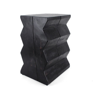 As Shown: Bandera Solid Wood End Table Size: 12.5 x 15.5 x 24.5 H inches Finish: Ebony Topcoat: Sealed Topcoat  Description: Bring in cutting edge style with a standout impactful piece of artistry that pays homage to 20th century artist, Constantin Brancusi. The saw tooth borders are a graphic contrast to natural graining and cracks inherent to the wood. Rough-cut solid pine logs are harvested in the mountains of Northern New Mexico, dried in a solar kiln, shaped and sanded by hand, then finished per your specifications.