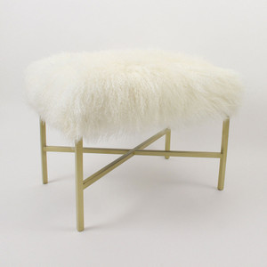 As shown: Wilshire Mongolian bench Dimensions: 20 x 15 x 18 hinches Materials: Mongolian Hide, Satin Brass Color: White  Description: We love how the sleek metal frame on this elegant stool allows the sumptuous, curly hide to seem as if it is floating in the air. It has a firm upholstered seat and is available in four standard colors and two metal finishes.