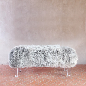 As shown: Beverly Modern Mongolian Bench Dimensions: 48 x 15 x 18 H inches Materials: Mongolian Hide, Lucite Legs Color: Grey Frost  Description: It's easy to love this sumptuous Mongolian fur bench in designer-quality hair-on lambskin. Carefully curated for your interior, the firm, upholstered frame is available in four lengths and four natural colors. We especially love the clear acrylic legs that allow it to float elegantly above the ground.