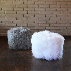 As shown: Ski Lodge Mongolian Stool Dimensions: 20 diameter x 16 H inches Materials: Mongolian Hide Color: White and Light Grey  Description: Deep-pile hair-on Mongolian lamb hide in nine natural, undyed colors? Check. Modern materials styled for today's living? Check. Lift ticket for the ride up the mountain? Maybe not. But our handmade to order Ski Lodge Mongolian Stool meets all our criteria for spectacular designer chic in any décor, whether you're hurtling down the slopes or safely ensconced in the lodge.