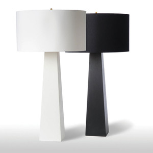 As Shown: Monolith Table Lamp Size: 18 diameter x 34 H inches Material: Ceramic composite Color: Black, White Shade: Silk Drum  Description: Minimal in design, the three tones of these Monolith table lamps of ceramic composite are anything but insular or impersonal. Pillars of brilliance, choose from white, black or gold leaf, and a black or white gold-lined silk drum shade. Place singly or in groups for maximum effect.